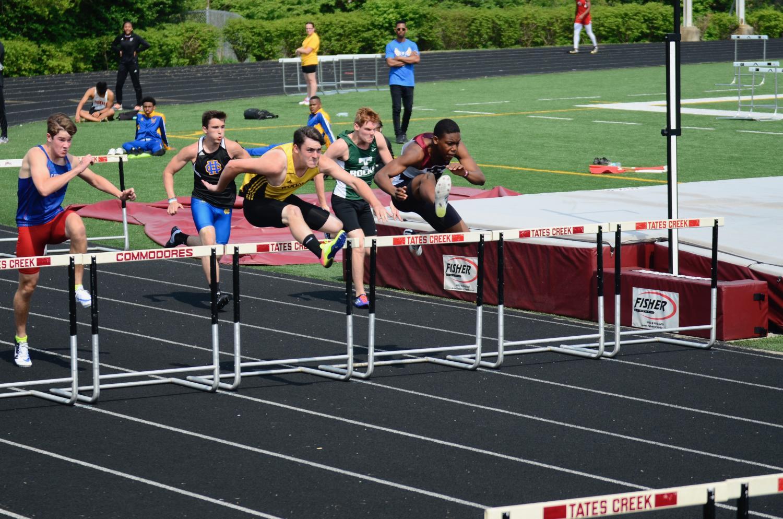 Landon Saum running the hurdles.