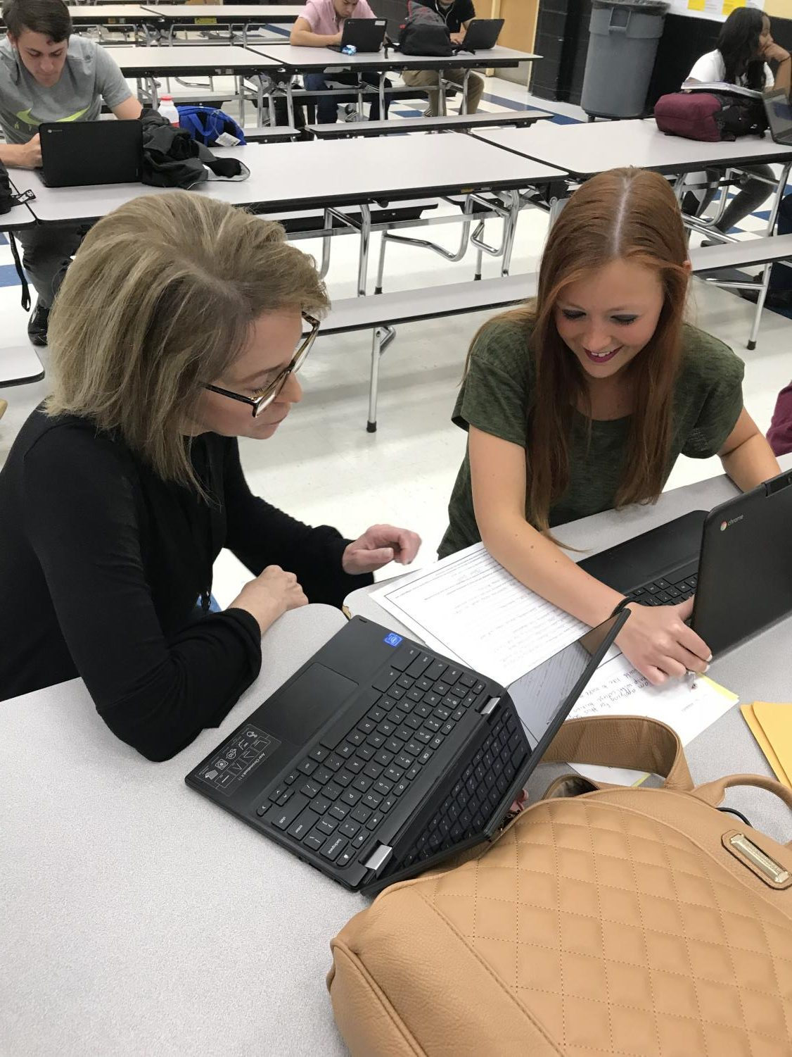 Mrs. Walters-Parker works with a student during class