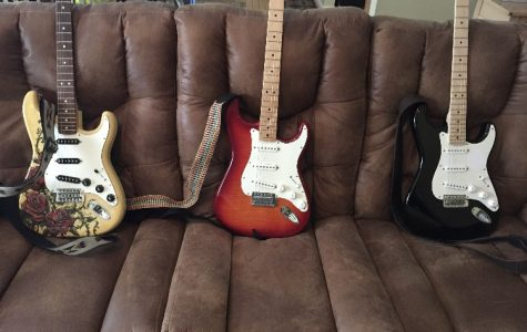 Three Stratocasters on a couch
