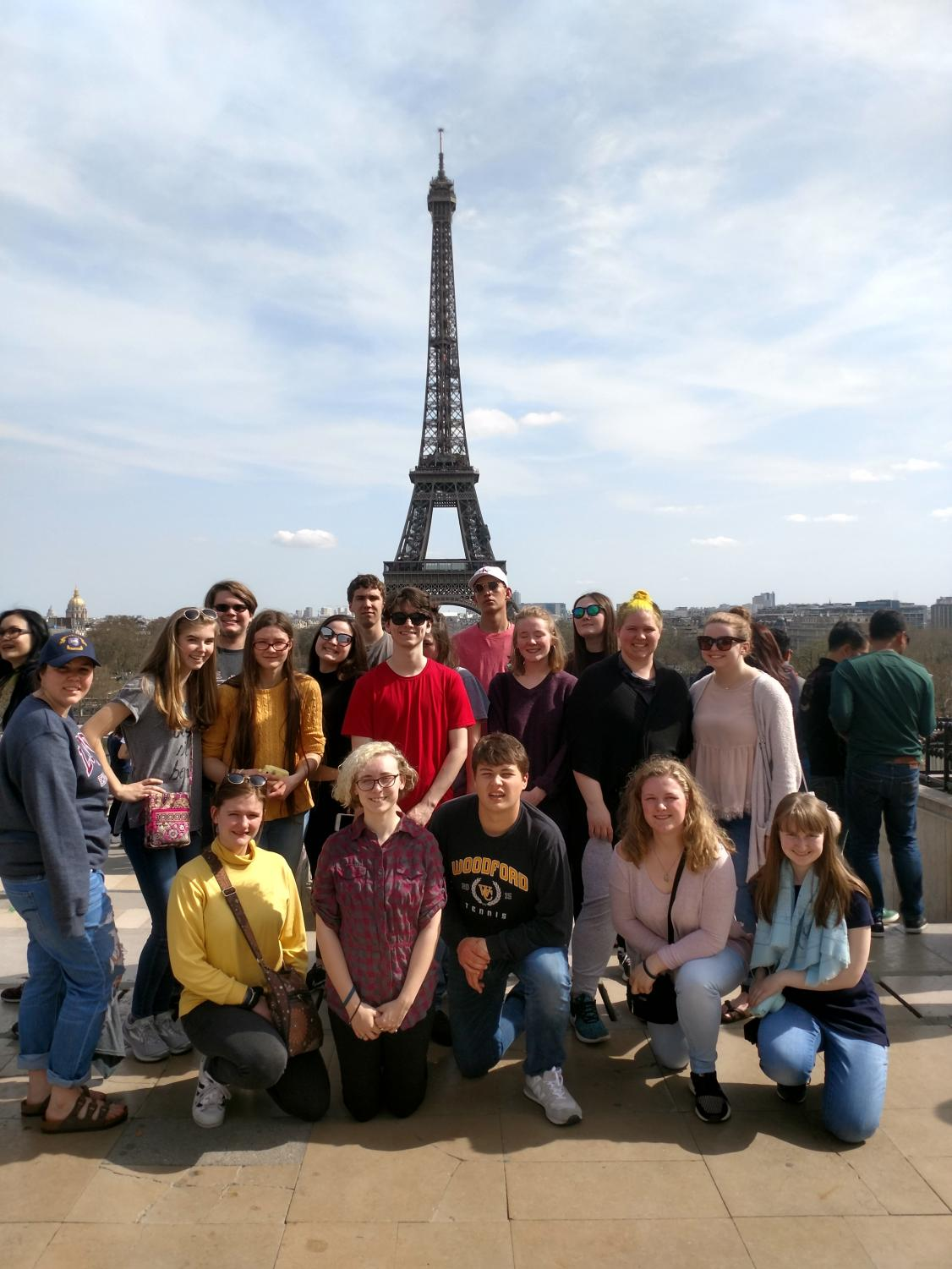 All attendees of the Woodford County Europe Trip Pose in front of the Eiffle Tower. (Back Row: Connor Akers (11),  Liam Burke (11), Sarah Goforth (11) Middle Row: Hannah Brady (11), Addison Beck (11), Hannah Kinkade (12), Emily Brookfield (11), Caleb Cheser (11), Maddie Gatewood (11), Josie Coyle (11), Audrey Spillman (10), Caroline Crane (11) Front Row: Grace Royalty (11), Emily Tackett (11), Mason McIntyre (11), Anna Manges (11), Amanda Cooper (12).)