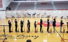 The Archery Team shoots a practice round. Photo by Morgan Fitzpatrick.