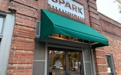 The Spark Community Cafe's sign is lit up for opening night.