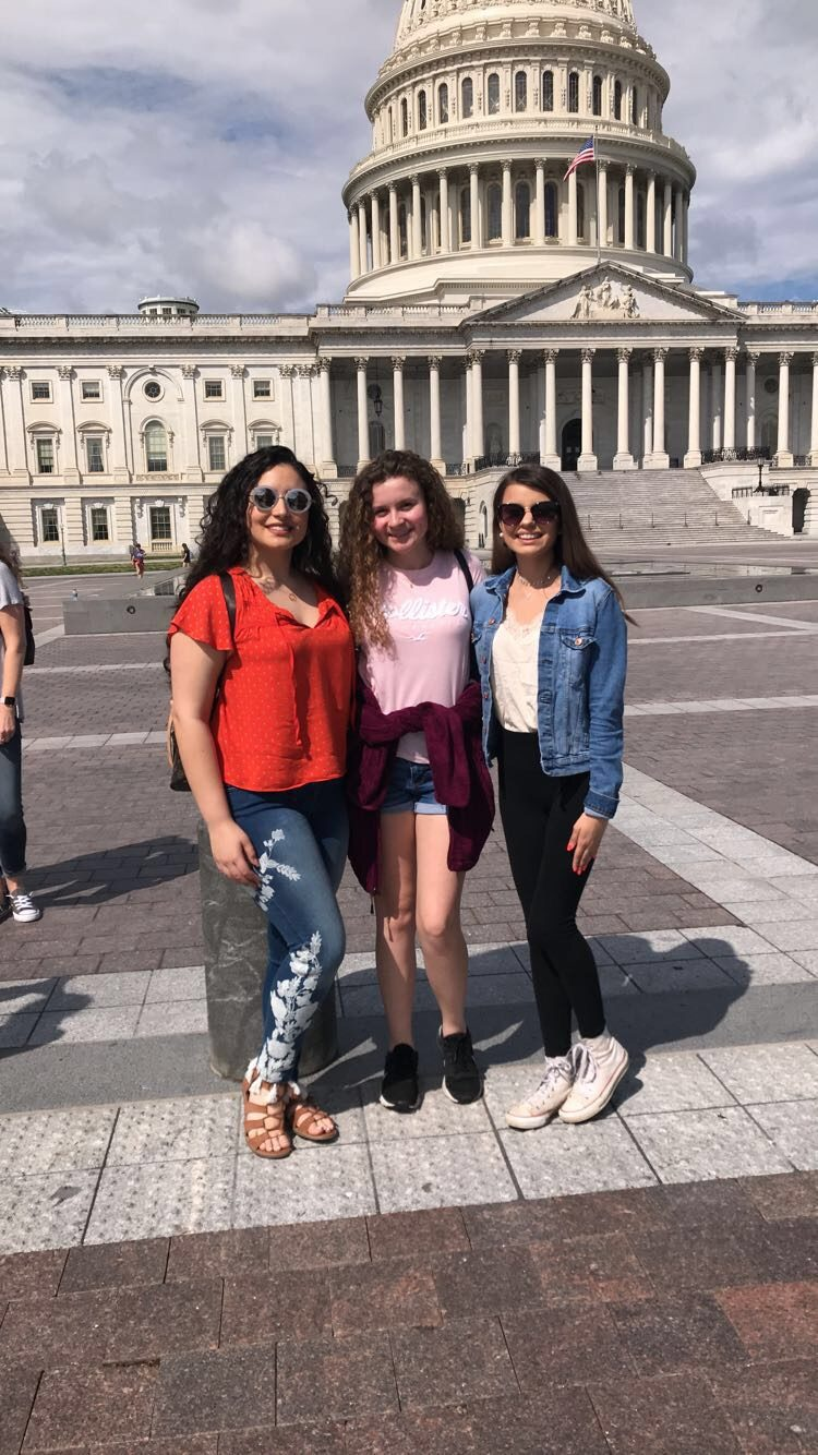 Anna Ward, Eden Alqahtani, and Katelyn Cooper in front of the Capitol Building.