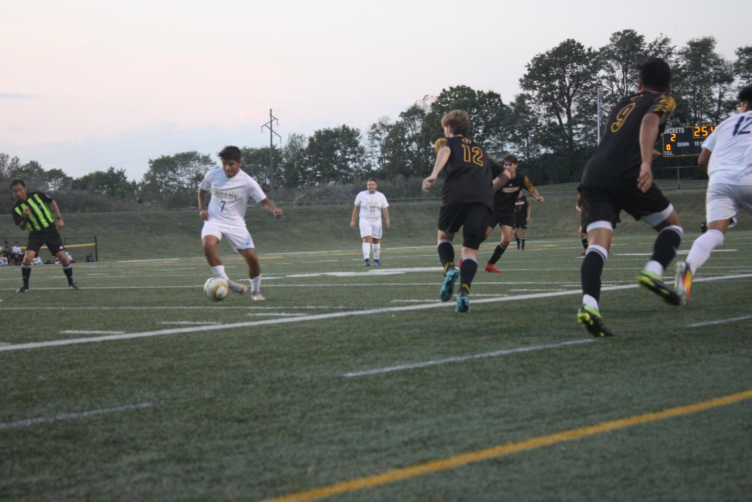 Seniors, Zack Ball #12 and Juan Velasco #9 fight together to win the ball back.