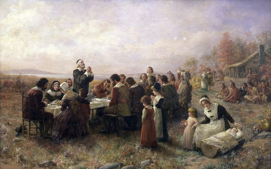 People gather at the first Thanksgiving in Plymouth.