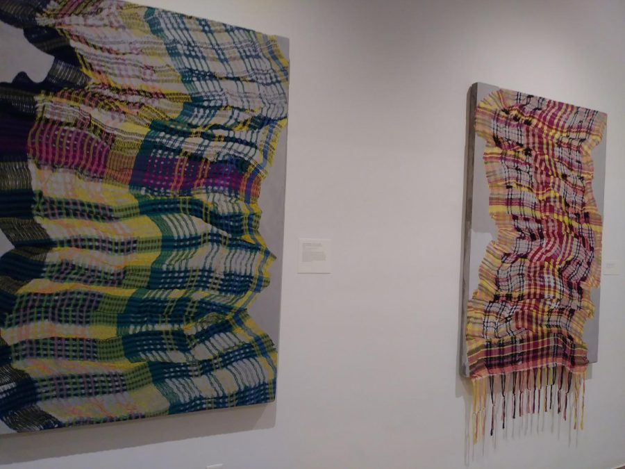 Portrait of a Plaid (green-yellow-pink-black) and Portrait of a Plaid (red-yellow-black) (Left to Right) created by Crystal Gregory as part of the Interwoven exhibition.