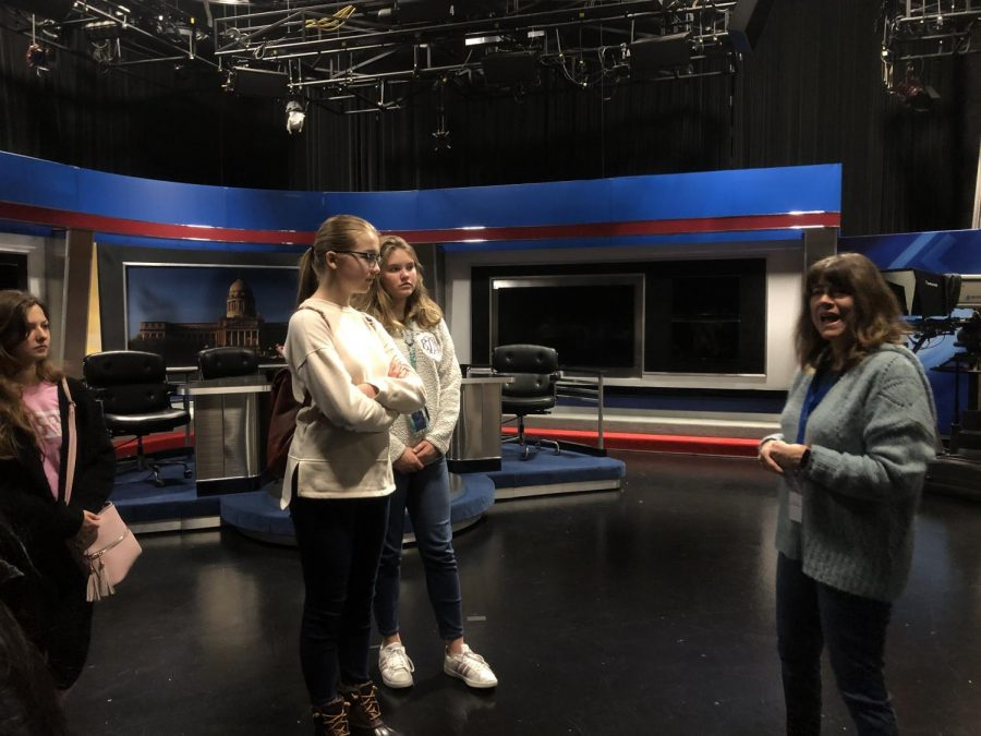 Cynthia Warner leading students through Studio A and explaining the set.
