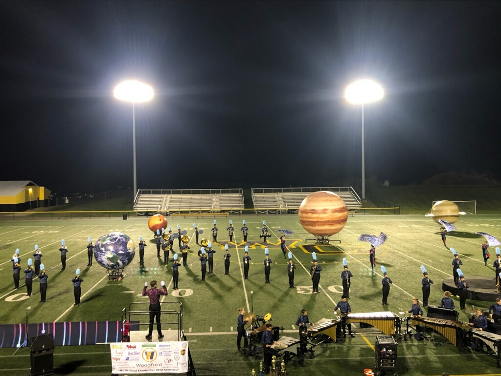 The marching band in place at the end of the first movement of their show.