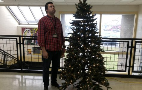 Mr. Wilkins stands by the school's Christmas tree ready for a break. Photo by Jamie Hobbs.