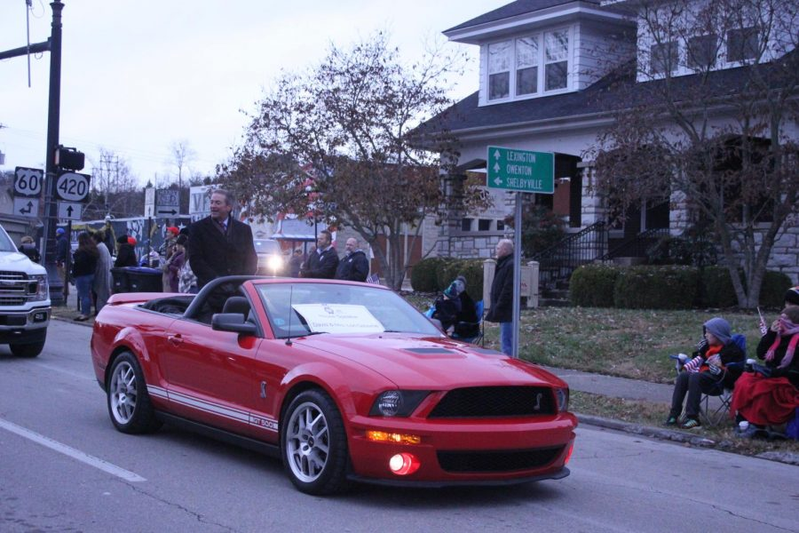 Member of the Kentucky House of Representatives David Osborne rides by in a bright red Mustang.