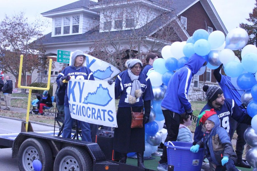 The Kentucky Democrats go by on a float as they throw candy to the children in the crowd.