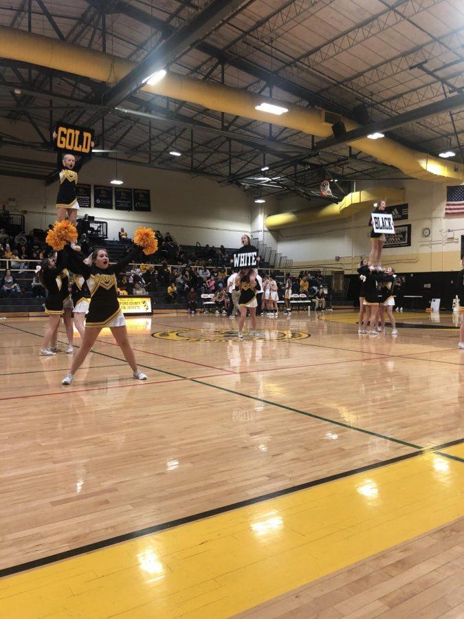WCHS+Cheerleaders+cheer+on+the+Woodford+Varsity+team.+