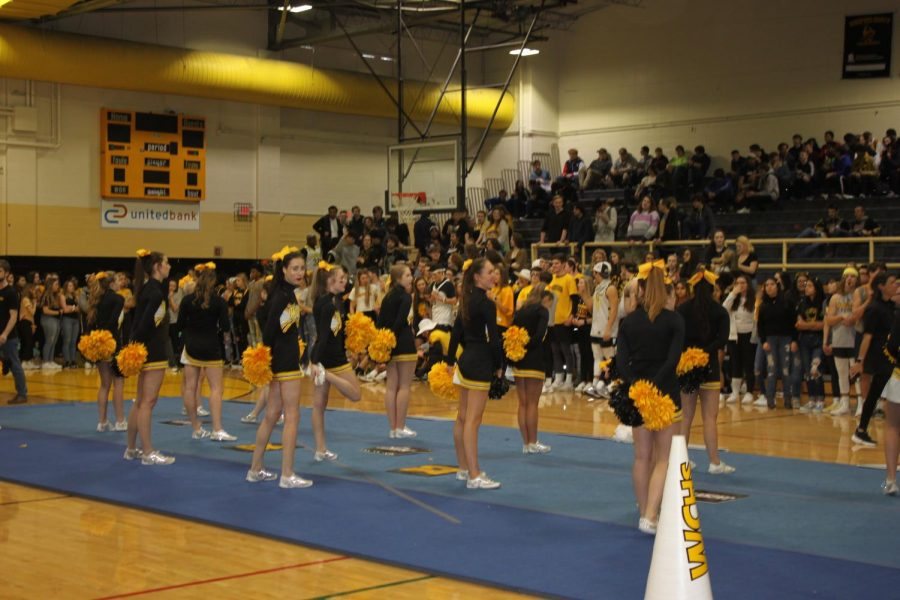 The+Woodford+cheerleaders+start+off+the+pep+rally+with+their+traditional+routine.+