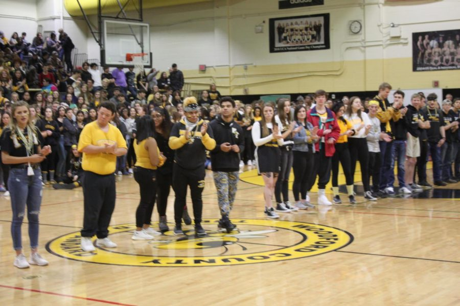 Senior+athletes+get+called+down+to+be+recognized+at+the+pep+rally.