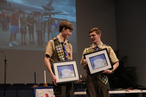 Landon Oxley and James Hawkins hold their certificates for earning Eagle Scout after their Court of Honor.