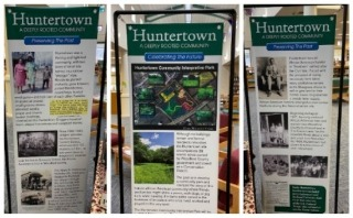 Huntertown project display in the WCHS library.