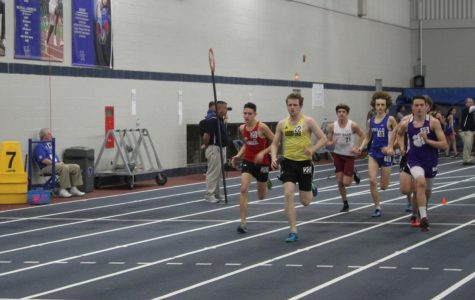 Colin Charles (12) leads his heat in the boys 1 mile race. Charles finished his race with a time of 5:14.6. This was Charles's first indoor track meet and he felt pretty good for his first race.