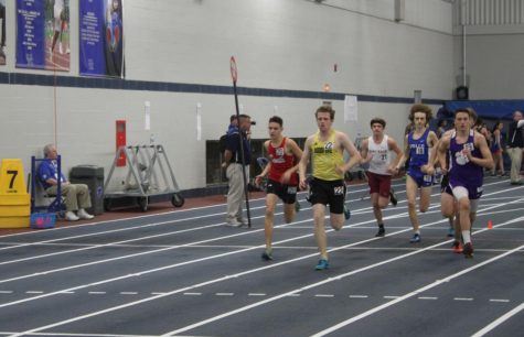 Colin Charles (12) leads his heat in the boys 1 mile race. Charles finished his race with a time of 5:14.6. This was Charles