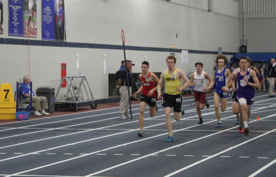 Colin+Charles+%2812%29+leads+his+heat+in+the+boys+1+mile+race.+Charles+finished+his+race+with+a+time+of+5%3A14.6.+This+was+Charles%27s+first+indoor+track+meet+and+he+felt+pretty+good+for+his+first+race.+%22The+indoor+air+is+a+lot+different+than+outdoors%3B+it+hit+me+pretty+hard%2C%22+said+Charles.+%22I%27m+hoping+this%27ll+be+a+good+springboard+for+the+rest+of+the+outdoor+season.%22