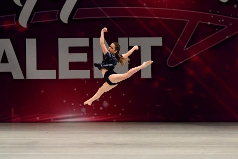 Julia Huff seems to float in the air during her dance routine.