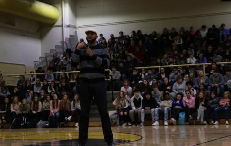 Devine Carama speaks to the entire student body at WCHS.