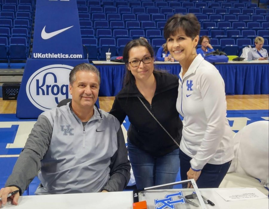 Elizabeth Mudd (Middle) pictured with University of Kentucky Men's Basketball Coach, John Calipari (Left), and his wife, Ellen Calipari (Right).