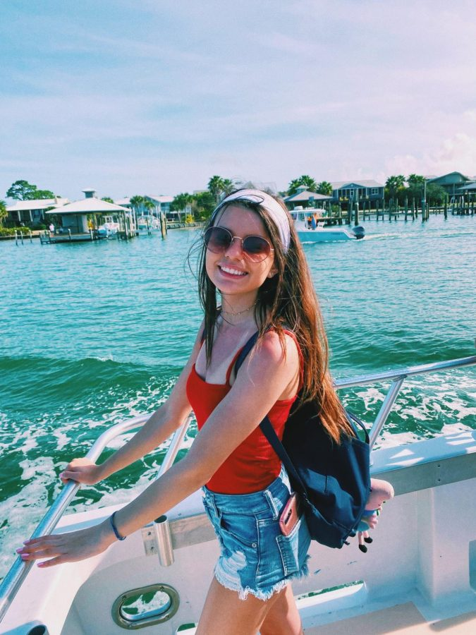 Anna Ward poses for a picture while boating in Mobile, Alabama.