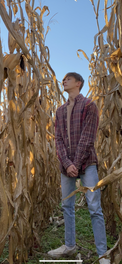 Noah Creech in a corn field in Versailles, Kentucky