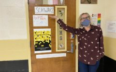 Ms. Schwarz in front of her classroom.
