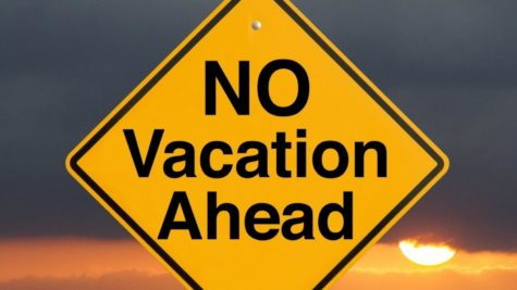 A yellow and black no vacation sign.