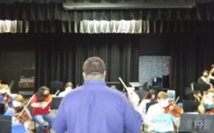 Mr. Marsee conducts the orchestra.