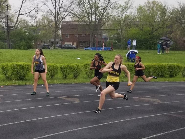 Emily Jetton (12) running at a track meet.