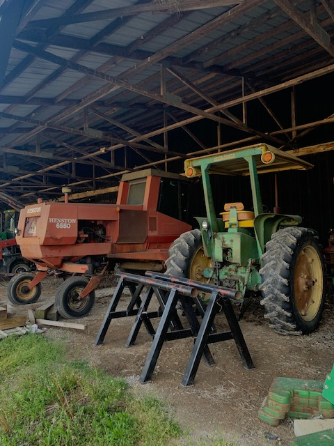 Tractors wait to be used and stored in the black barn.