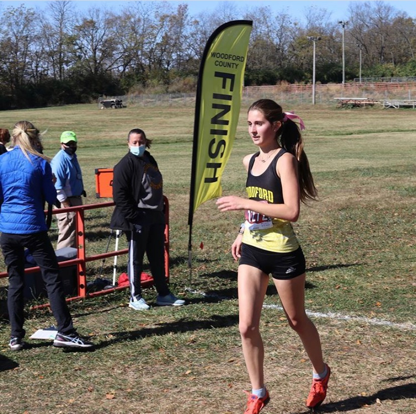 McKenna completing her race at the Woodford County Invitational.