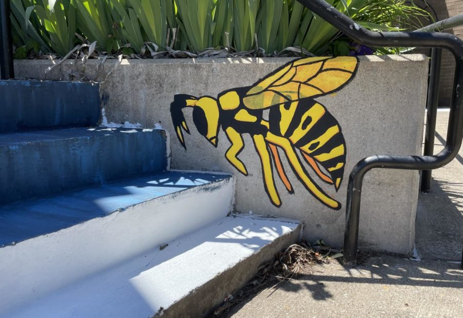 A yellowjacket on the side of the staircase