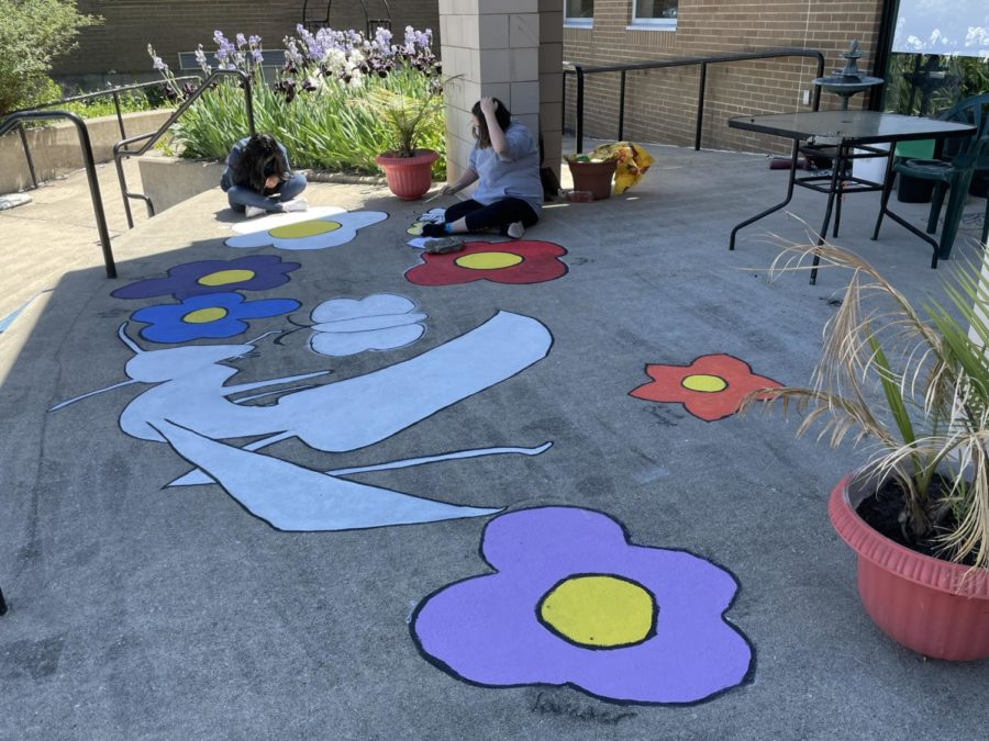 Wide view of students working on the main flower/yellowjacket mural