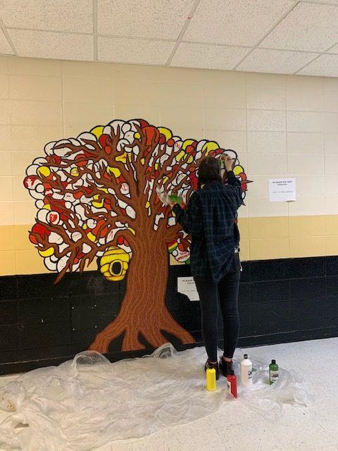 Keelie working on the diversity mural.