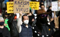 A man holds a sign at the